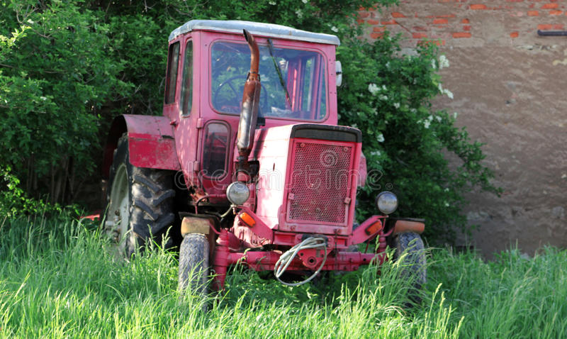 View on old tractors in a rural scene by daylight stock photo