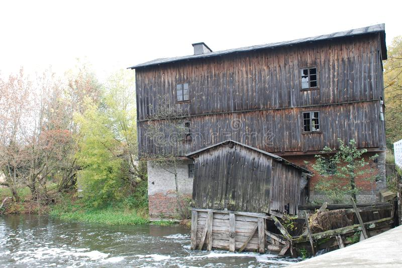 Old Water Mill on River. View on Old Water Mill on Rawka River in Skierniewice Poland stock images