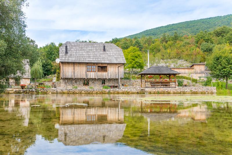 View of old wooden mill at gacka river in central croatia stock photography