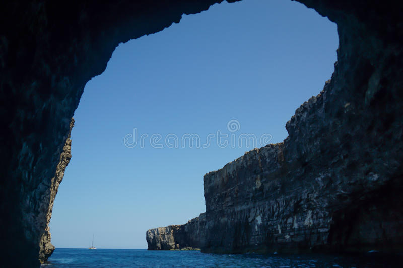 A view from one of the caves in Comino, Malta royalty free stock photo