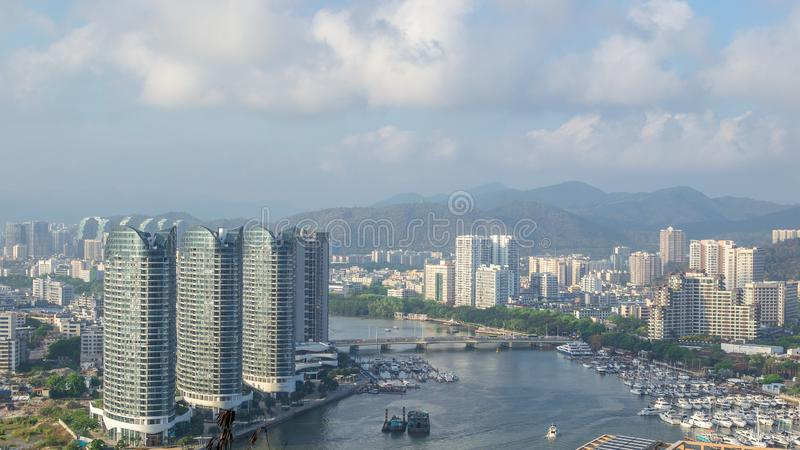 View of one of the districts of Sanya city. Visible are the skyscrapers and the public ferry terminal. Hainan, China. View of one of the districts of Sanya city royalty free stock images