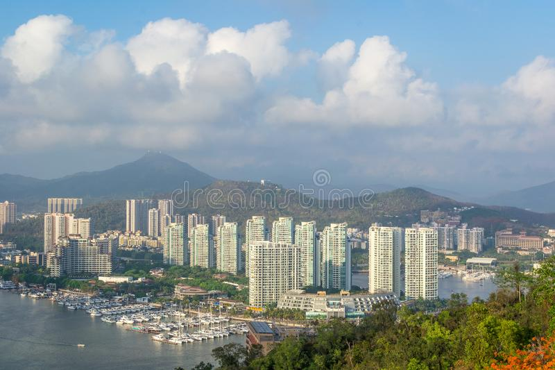 View of one of the districts of Sanya city. Visible are the skyscrapers and the public ferry terminal. Hainan, China. View of one of the districts of Sanya city stock image