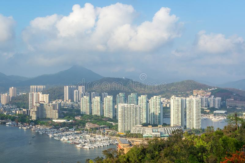 View of one of the districts of Sanya city. Visible are the skyscrapers and the public ferry terminal. Hainan, China. View of one of the districts of Sanya city stock images