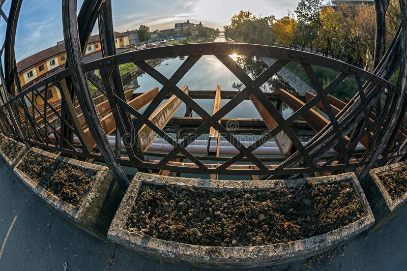 View from one of the oldest metal bridges in Timisoara, Romania. Over the Bega River, in the evening light royalty free stock images