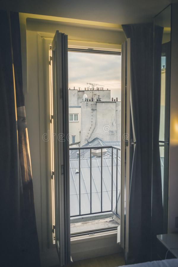 View through an open balcony door of rooftops royalty free stock image