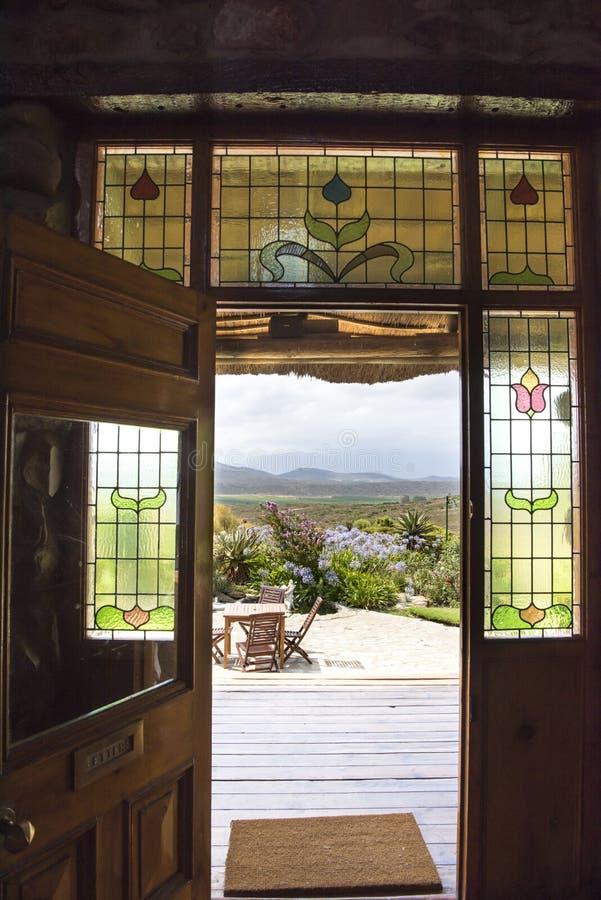 View through open door in beautiful landscape stock photo