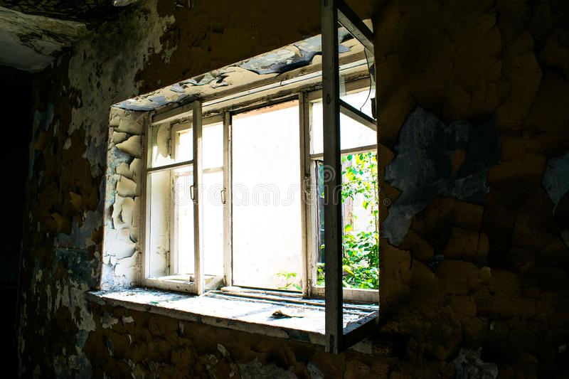View from the window in an old abandoned house stock photography