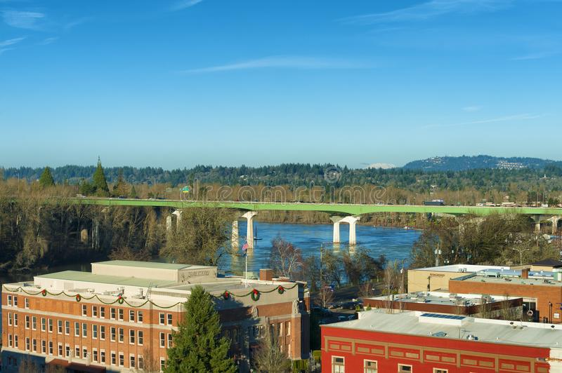 View from Oregon City Observation Tower. Oregon City, Oregon, USA - December 30, 2015: Looking over Oregon City downtown roof tops, I-205 crossed the Willamette royalty free stock images