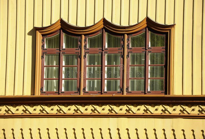 Ornamented rustic window. A view of the ornamented window of a wooden rustic cottage in Lithuania royalty free stock photo