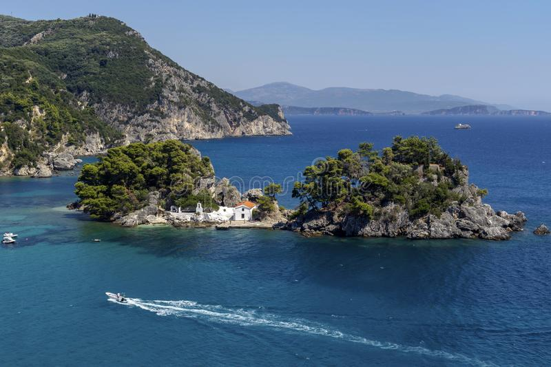 Church on a small island resort city Parga, region of Epirus, Greece. View of the Orthodox, Christian Church of the Mother of God on a small island in a sunny stock photography
