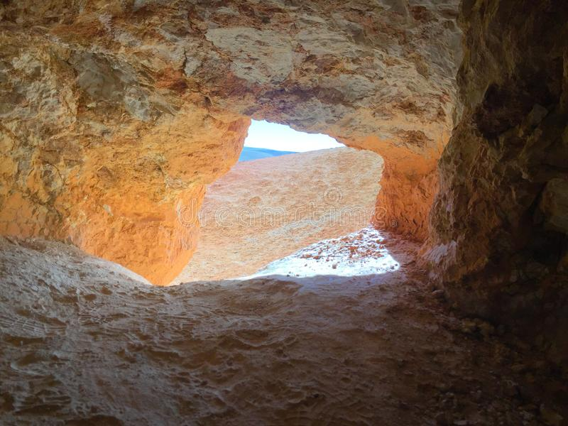 View out of cave. Martian landscape on Earth. Kyzyl-Chin or Altai Mars red rocks mountains. Altai. Russia stock image