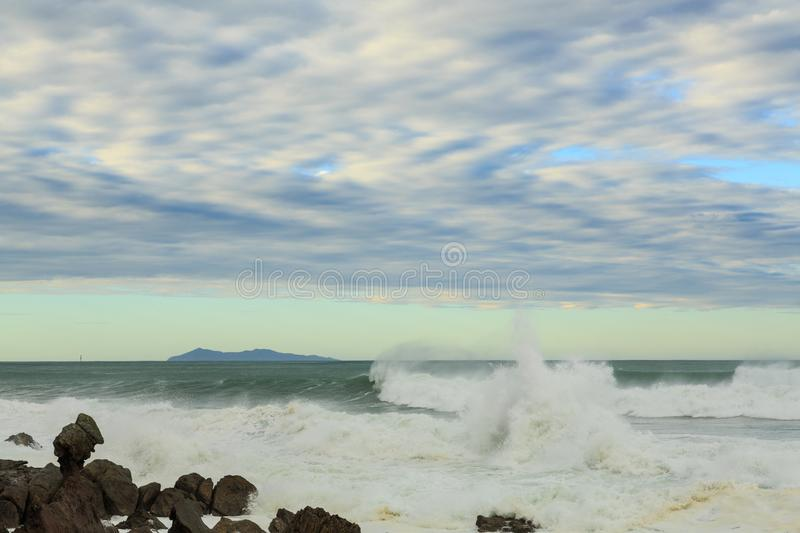 A stormy ocean, with large waves and fast-moving clouds stock photos