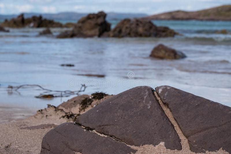 View out to sea from Achnahaird Beach in Wester Ross, Scottish Highlands. Quiet, cresent shaped beach on the north west coast of S. Cotland, with rugged rocks royalty free stock photos