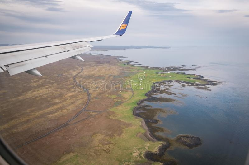 Flying Over Iceland in Spring. A view out the window of a jet as it lands in Iceland in late spring stock photo