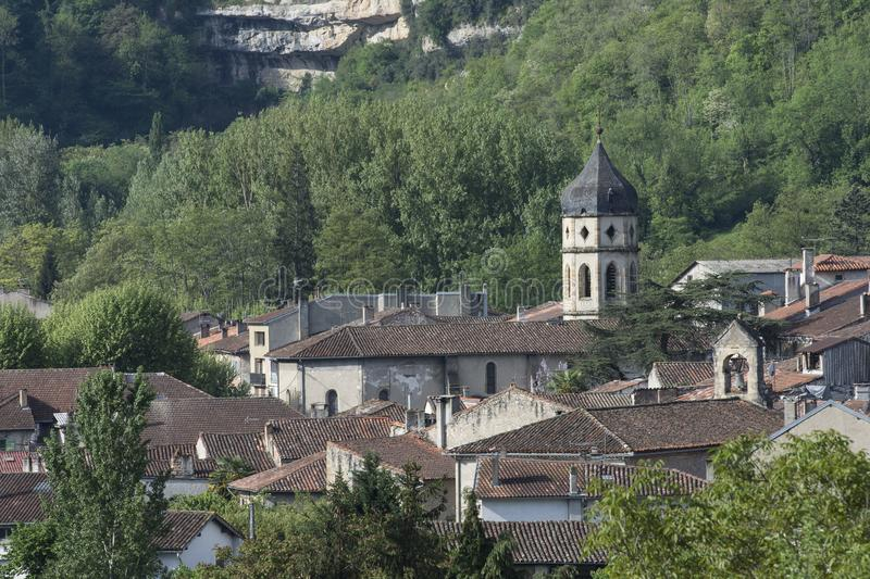 View over ancient rooftops in Ariege. France, with spire and forests in background royalty free stock photo