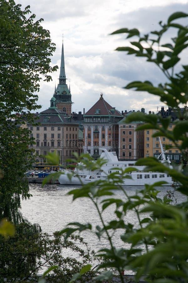 Colorful historic skyline stockholm through trees stock photos