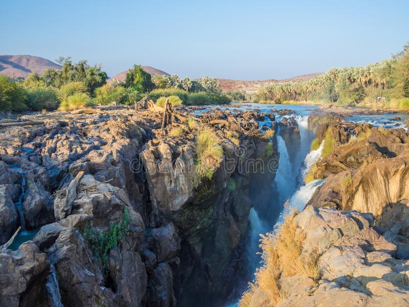 View over beautiful scenic Epupa Falls on Kunene River between Angola and Namibia in evening light, Southern Africa. View over beautiful scenic Epupa Falls on royalty free stock images
