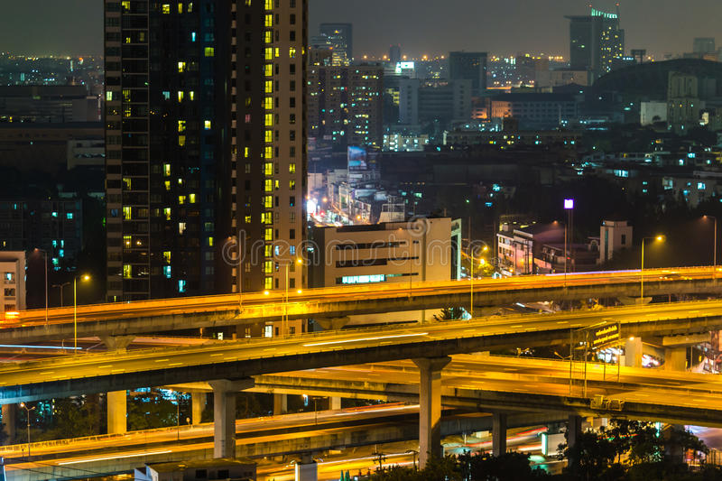 a view over the big asian city of Bangkok , Thailand at nighttime when the tall skyscrapers are illuminated stock photos