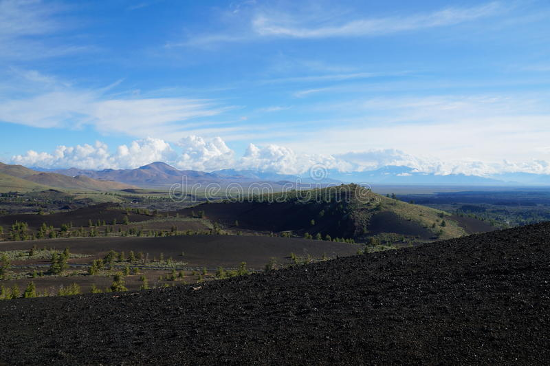 View over a black volcanic lava landscape from the Inferno Cone stock photography