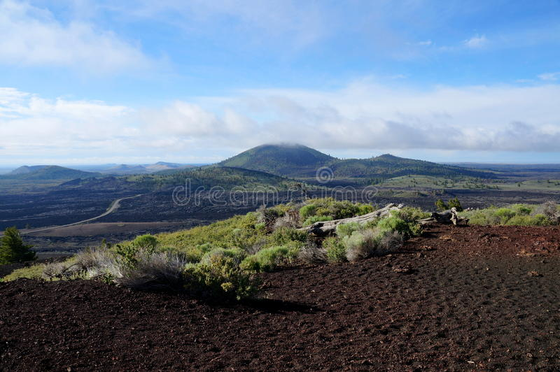 View over a black volcanic lava landscape from the Inferno Cone royalty free stock photo