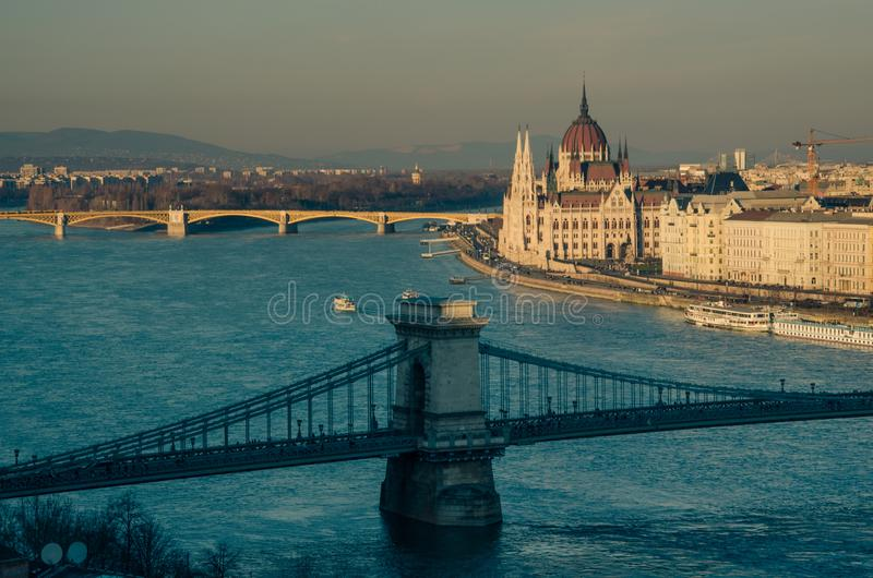 View over the Budapest city center, Chain Bridge over Danube river in the foreground and the Parliament building in the background. Budapest, Hungary - 12/25/ stock images