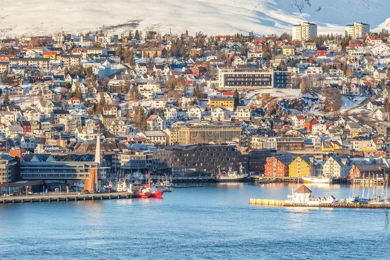 View over the city of Tromso and it`s marina in winter, North Norway. View of the sunset over the Tromso. Tromso is the biggest city of Northern Norway located royalty free stock images