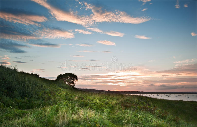 Download View Over Cliffs Bay At Sunset With Yachts In Bay Stock Photo - Image: 26879828
