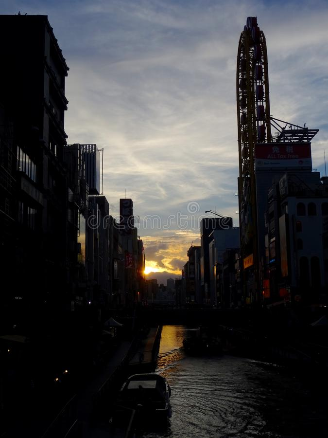 View over Dotonbori Canal at sunset. Beautiful view over the Osaka Dotonbori canal and his modern buildings at sunset royalty free stock photography