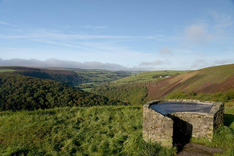 View over Exmoor from County Gate, North Devon. View from County Gate over valley to heather moors in Exmoor, North Devon stock photo