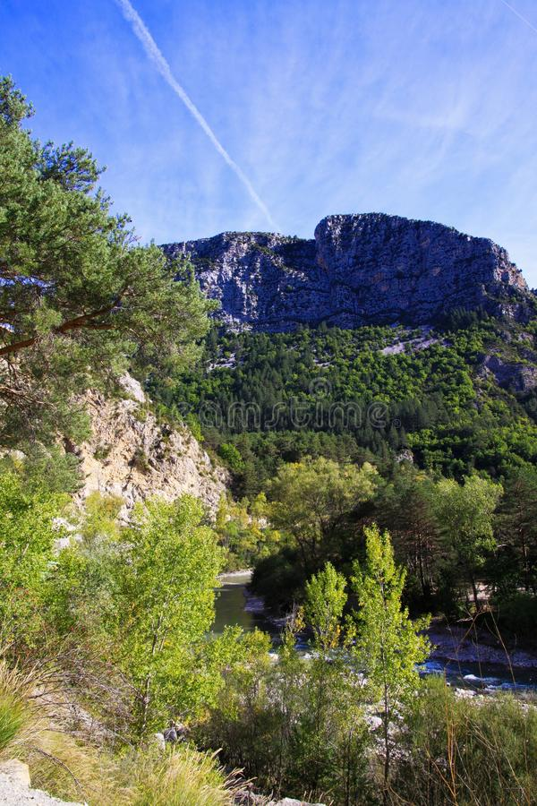 View over green valley on mountain peak against blue sky - Gorges du Verdon, Provence, France. View over green valley on mountain peak against blue sky - Gorges royalty free stock photo