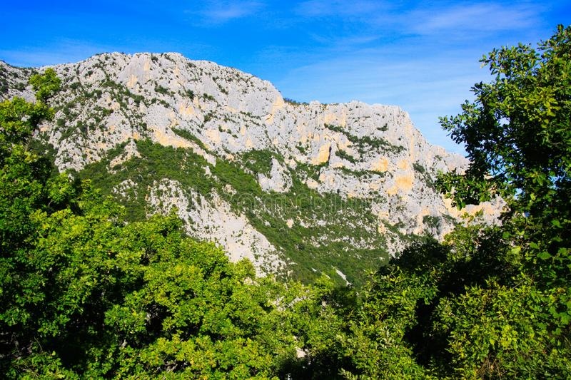 View over green valley on mountain peak against blue sky - Gorges du Verdon, Provence, France. View over green valley on mountain peak against blue sky - Gorges stock photos