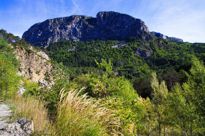 View over green valley on mountain peak against blue sky - Gorges du Verdon, Provence, France. View over green valley on mountain peak against blue sky - Gorges stock images