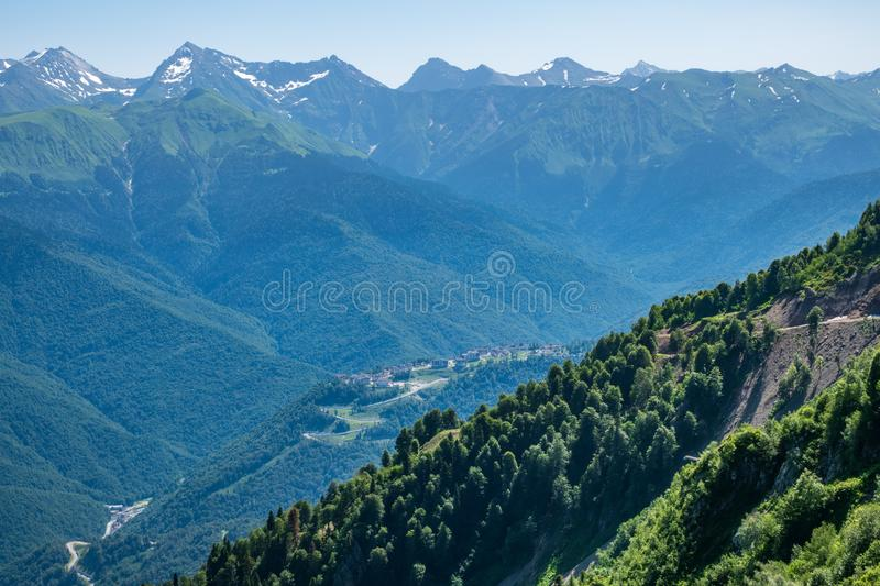 View over the Green Valley, surrounded by high mountains on a clear summer day. Krasnaya Polyana, Sochi, Russia royalty free stock photos