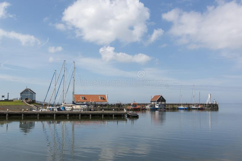 View over the harbor of Hindeloopen, historical city in the lake side district of the Netherlands. Hindeloopen, one of the eleven cities in the province of stock photo