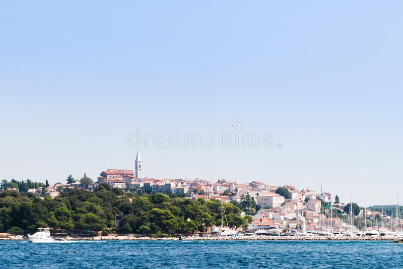 View over harbor and old town of Vrsar, Croatia, from the sea stock images