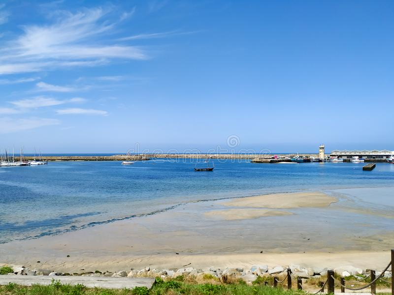 View over harbour of Povoa de Varzim, Portugal on a sunny summer day with blue sky. Wide angle stock photography