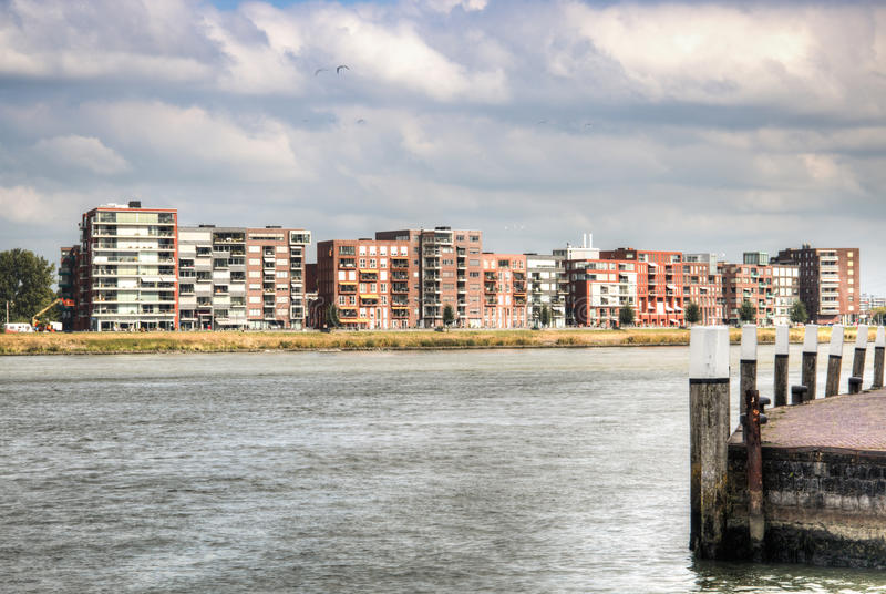 View over the Maas river in Dordrecht, Netherlands. With restaurants on the riverside stock photography