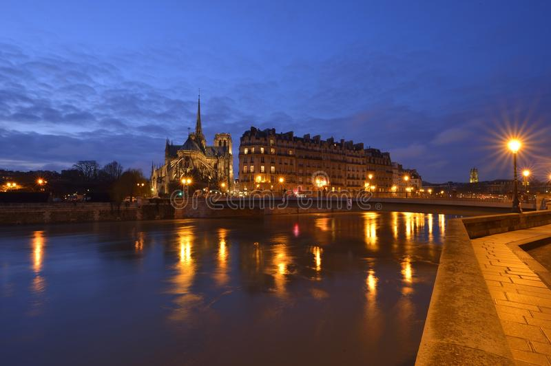 View over Notre-Dame de Paris. During the recent flood of the Seine, there was a special light reflection on the water royalty free stock photos