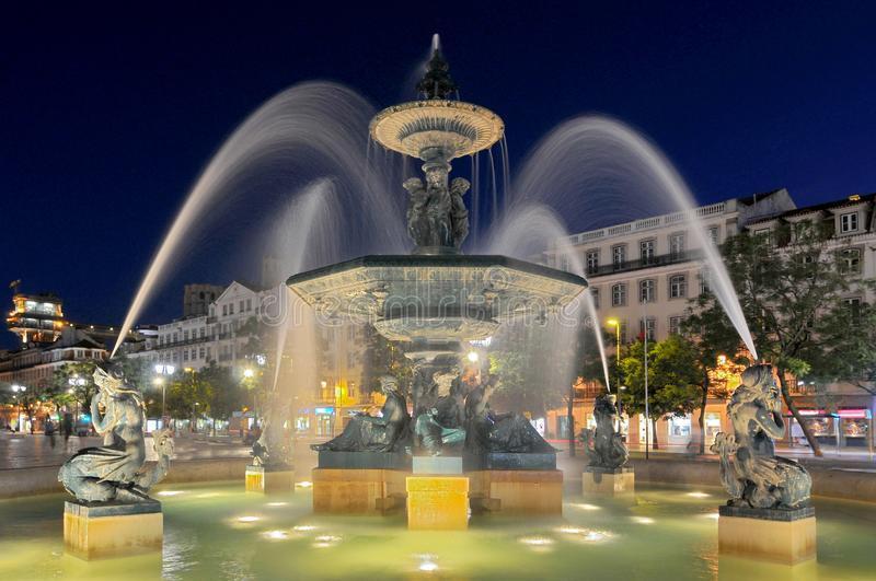 View over Praca de D. Pedro IV or Rossio with bronze fountain, statue of Pedro IV and national theatre, Lisbon, Portugal. royalty free stock photography