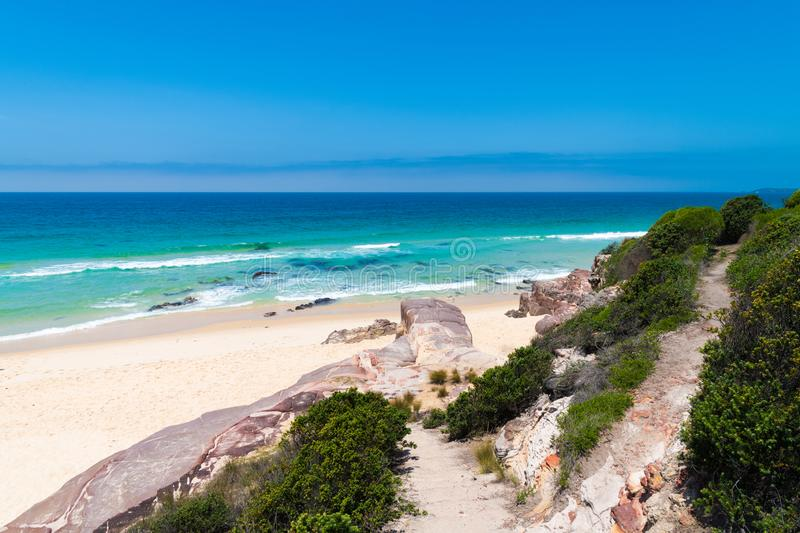 View over remote Quondolo Beach, located in Ben Boyd National Park, NSW, Australia, popular for surfing and rockpool exploring and. Subject to rips tides and royalty free stock photos