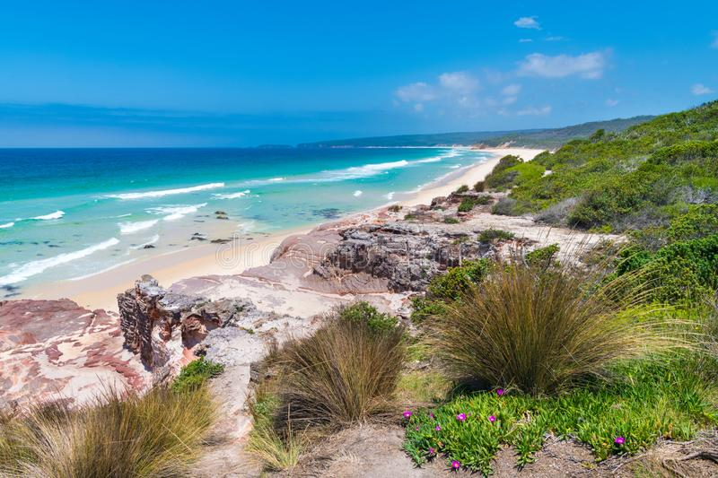 View over remote Quondolo Beach, located in Ben Boyd National Park, NSW, Australia, popular for surfing and rockpool exploring and. Subject to rips tides and stock photo