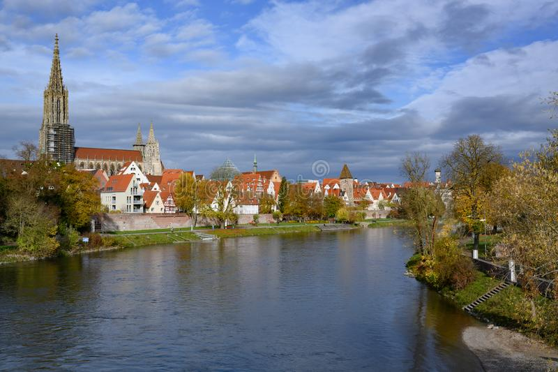 View over River Danube to city wall of Ulm and historic houses with famous Ulm Minster, Baden-Wuerttemberg, Germany stock photos