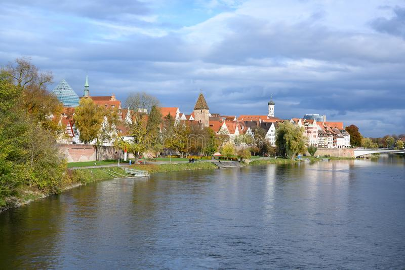 View over River Danube to historic houses and city wall of Ulm, Baden-Wuerttemberg, Germany stock image