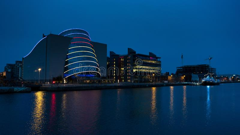 Modern Convention Centre in Dublin, Ireland at night with reflections in river royalty free stock photos