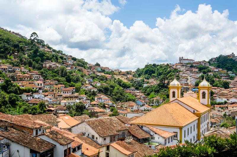 View over the rooftops of the colonial old gold mining town of Ouro Preto in Brazil. Looking down over the rooftops and churches of the colonial old gold mining royalty free stock photo