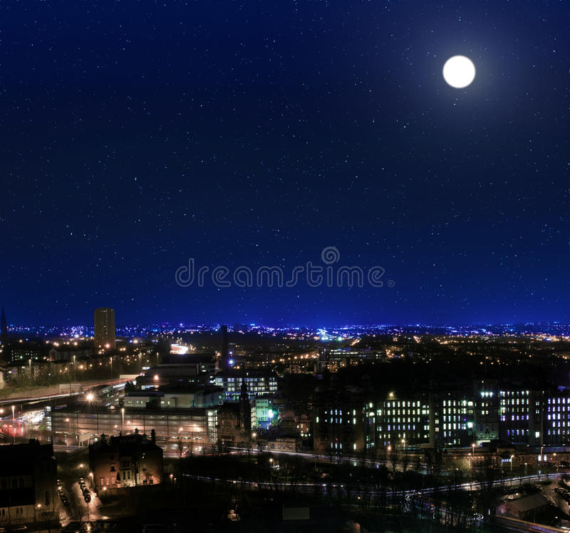View over the rooftops towards Glasgow Royal Infirmarynight. View over the rooftops towards Glasgow Royal Infirmary at night royalty free stock image