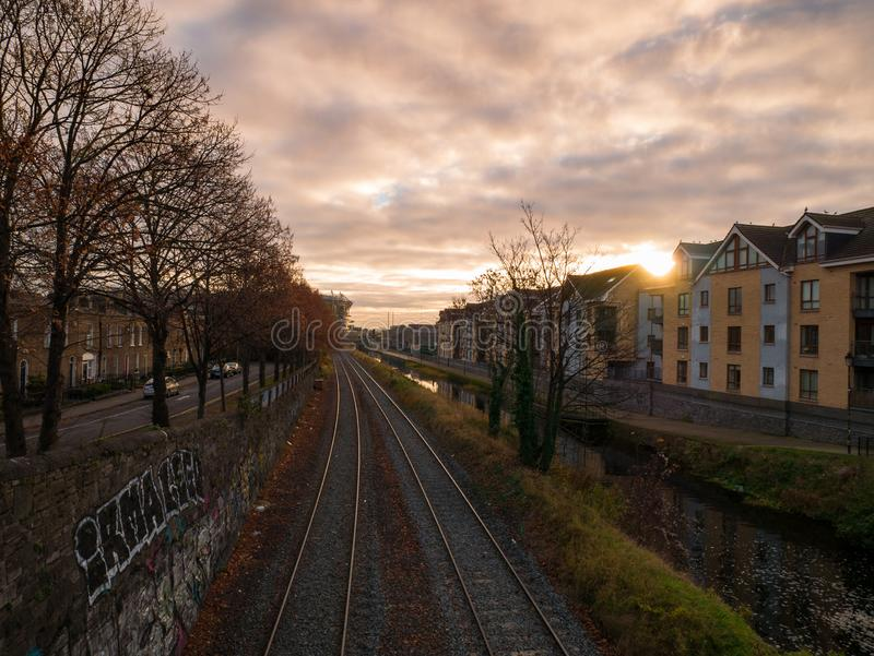 View over Royal Canal and rail tracks in Dublin, Ireland at sunrise stock photography