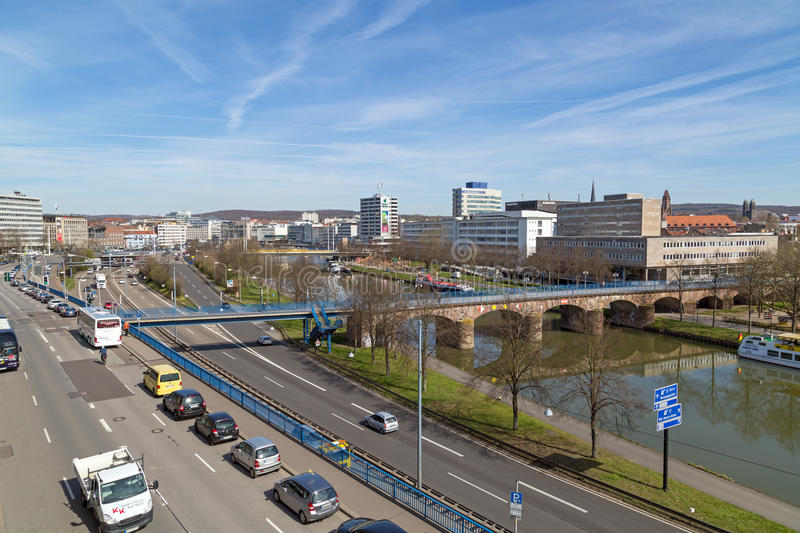View over Saarbrucken. SAARBRUCKEN, GERMANY - APRIL 10: View over Saarbrucken, the river Saar and the highway next to the river on a sunny spring day. April 10 stock photography
