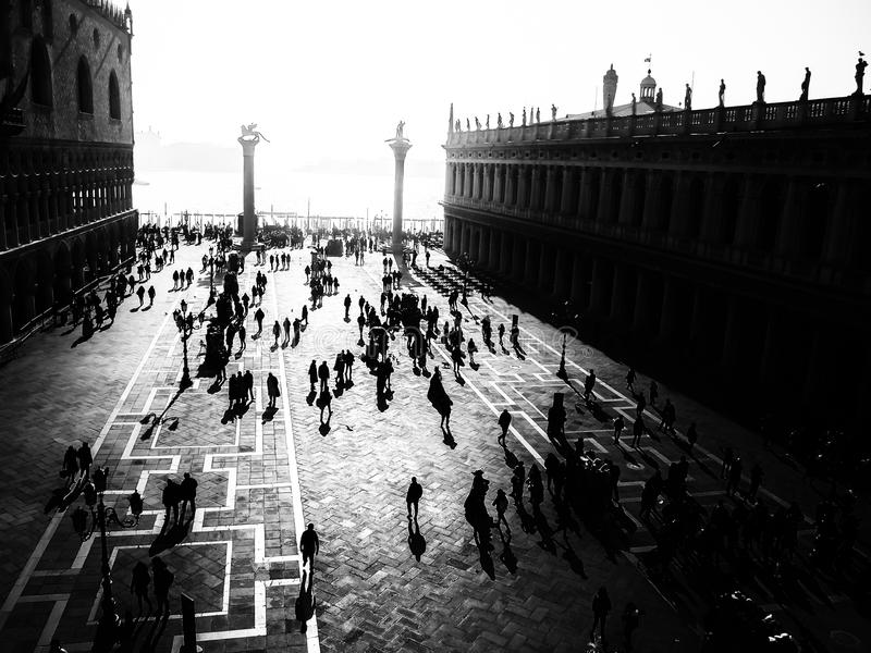 Venice on a Busy Carnival Morning. View over Saint Mark`s Square with a dark and mysterious mood royalty free stock photo