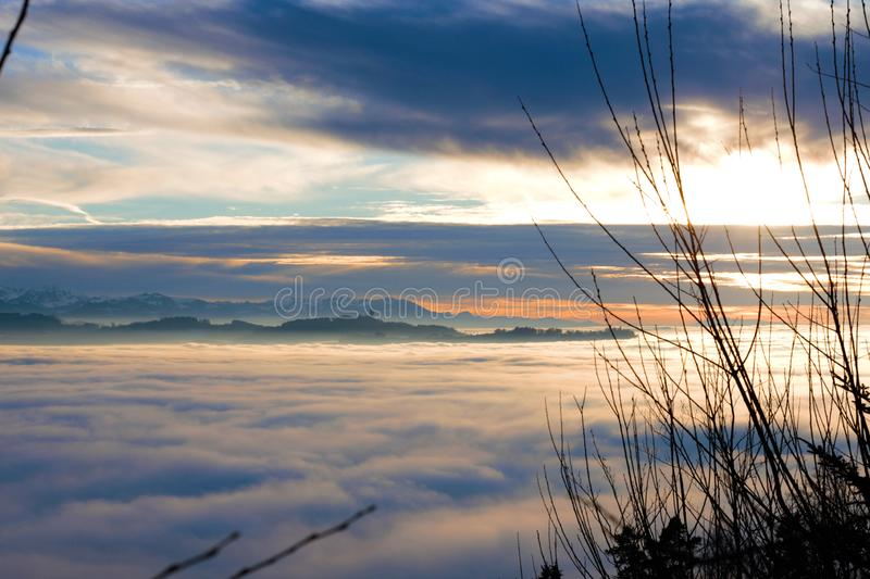 View over the sea of fog. Gurten and alpine panorama in the background stock image